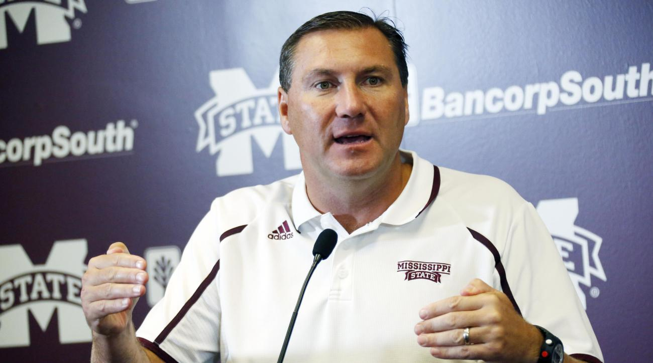 Mississippi State football coach Dan Mullen answers questions from reporters about the upcoming season, during media day, Friday, Aug. 7, 2015, in Starkville, Miss. (AP Photo/Rogelio V. Solis)