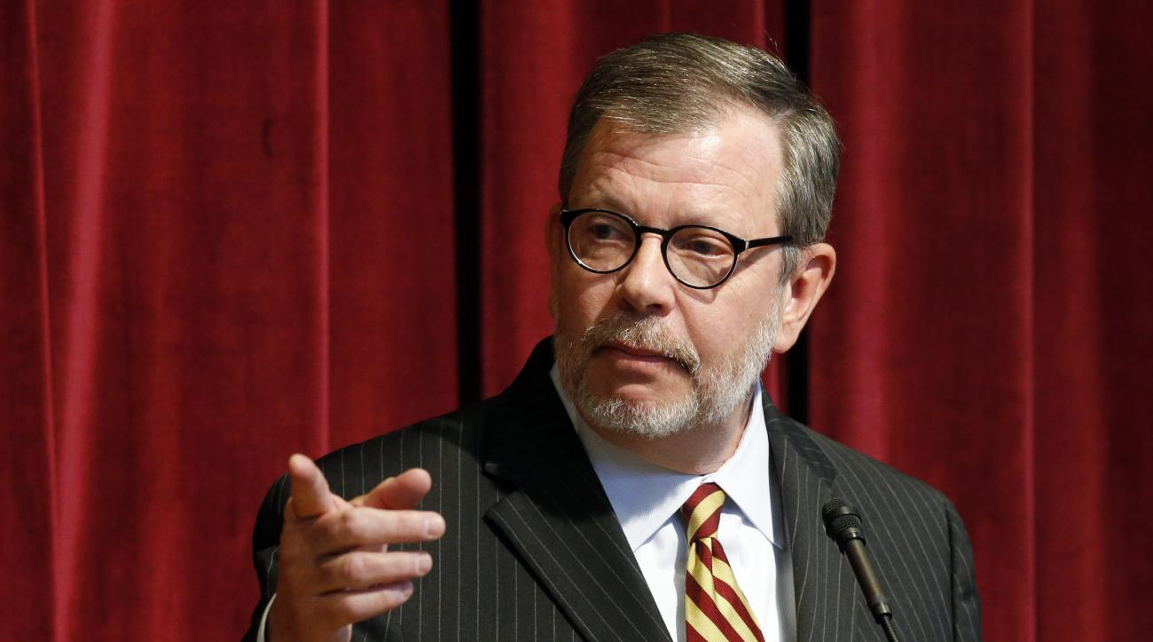 University of Minnesota President Eric Kaler gestures toward a reporter during a press conference announcing the resignation of athletic director Norwood Teague, Friday, Aug. 7, 2015 in Minneapolis. Kaler said in an email to staff that Teague's resignatio