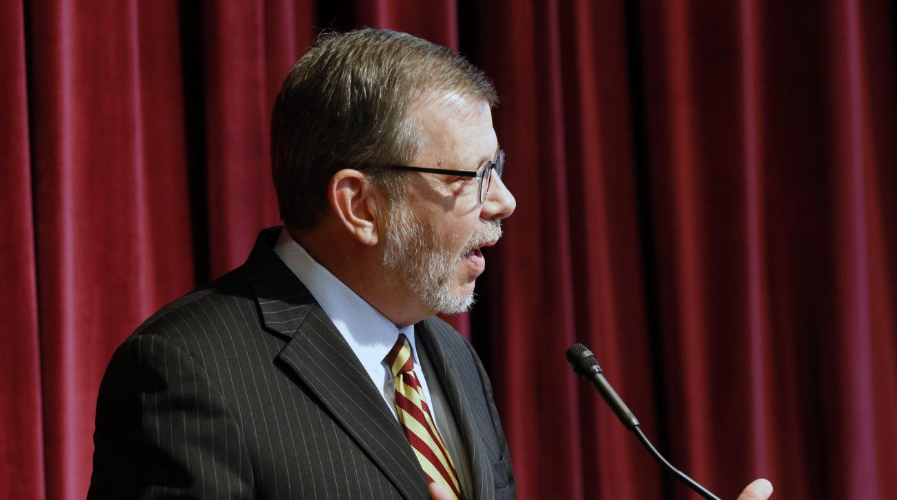 University of Minnesota President Eric Kaler addresses questions after he announced the resignation of athletic director Norwood Teague, Friday, Aug. 7, 2015 in Minneapolis. Kaler said in an email to staff that Teague's resignation followed reports that h