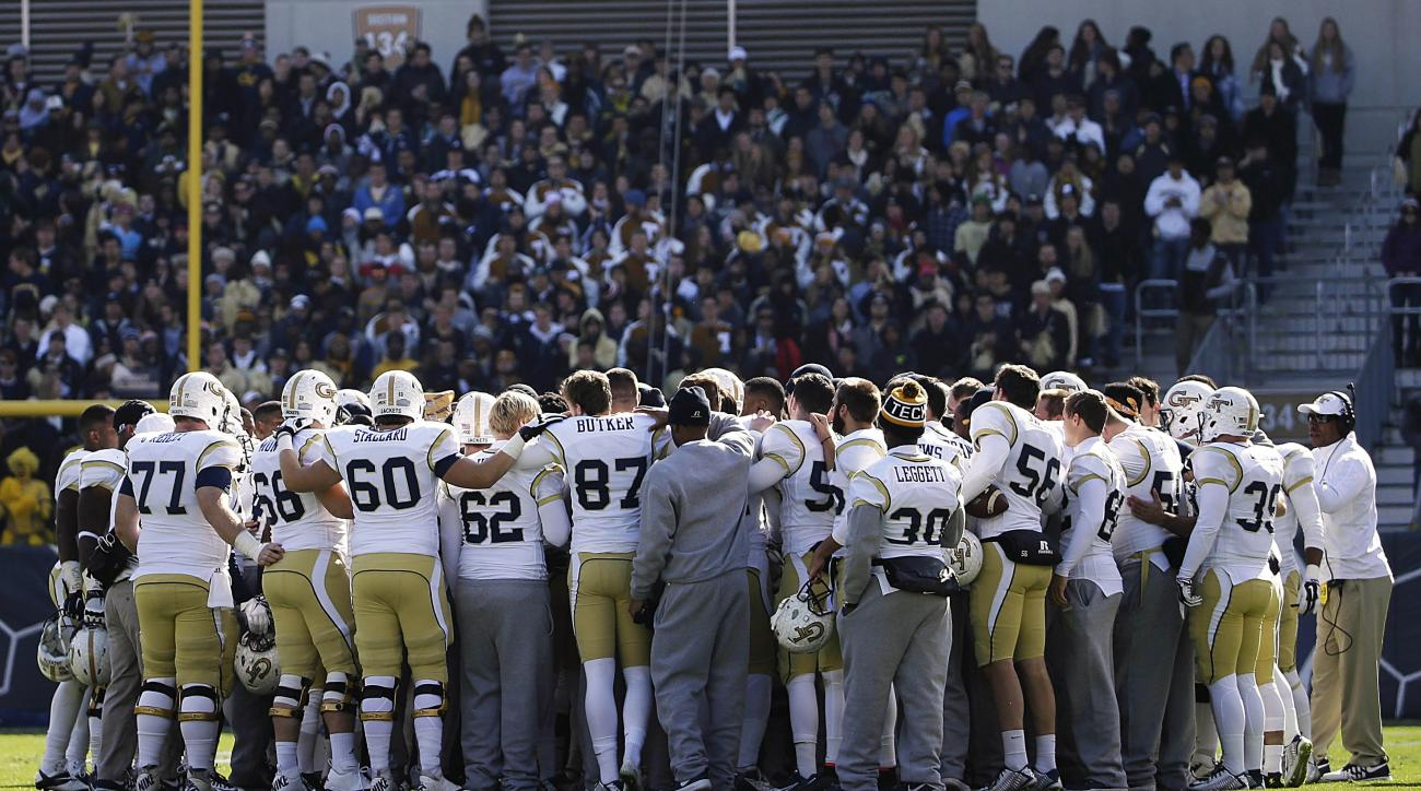 FILE - In this Nov. 15, 2014, file photo, Georgia Tech players surround teammate Broderick Snoddy as he is tended to by medical personnel after breaking his leg in the second quarter of an NCAA college football game against Clemson in Atlanta. Snoddy was