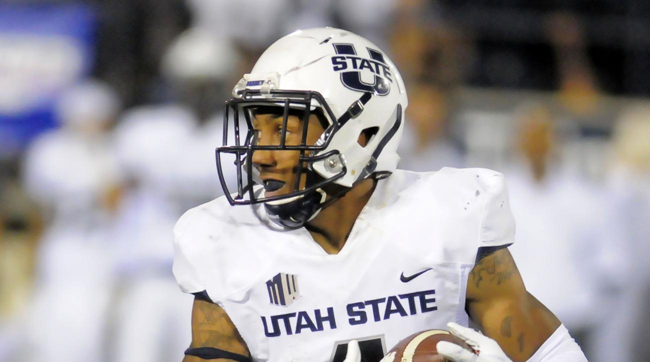 Utah State wide receiver Hunter Sharp (4) carries the ball during an NCAA football game against Wake Forest, Saturday, Sept. 13, 2014, in Logan, Utah. (AP Photo/Eli Lucero)