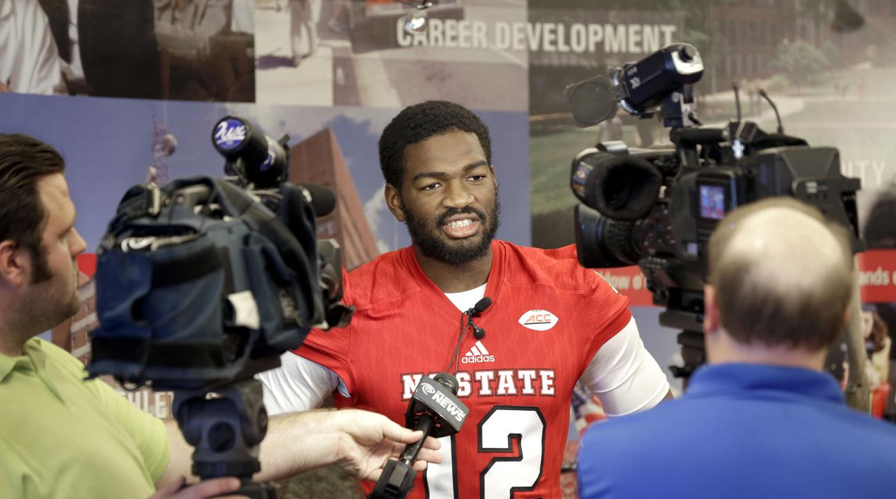 North Carolina State quarterback Jacoby Brissett is interviewed during the team's NCAA college football media day in Raleigh, N.C., Sunday, Aug. 9, 2015. (AP Photo/Gerry Broome)