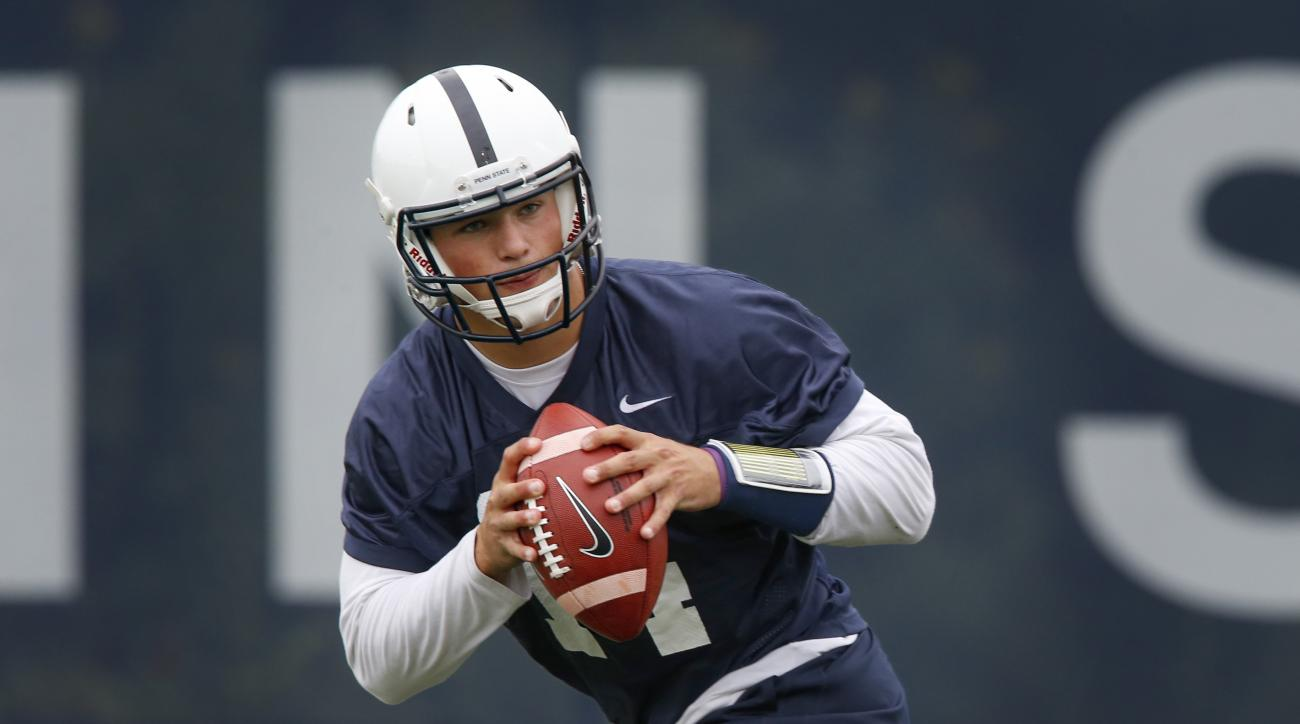 FILE -In this file photo from Aug. 6, 2015, Penn State quarterback Christian Hackenberg looks to pass during the NCAA college football team's practice, in State College, Pa. Hackenberg enters his third, and possibly final, season at Penn State as the  Nit
