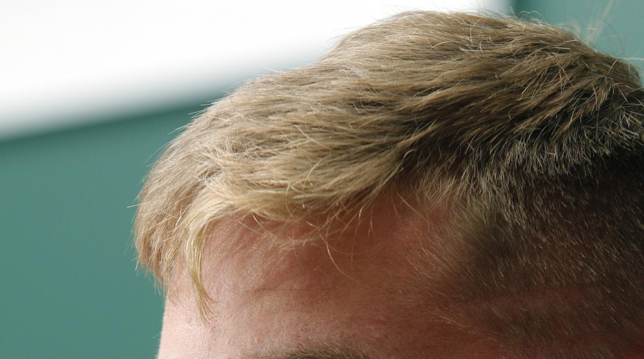 Michigan State quarterback Connor Cook is interviewed during the team's NCAA college football media day, Monday, Aug. 10, 2015, in East Lansing, Mich. (AP Photo/Al Goldis)