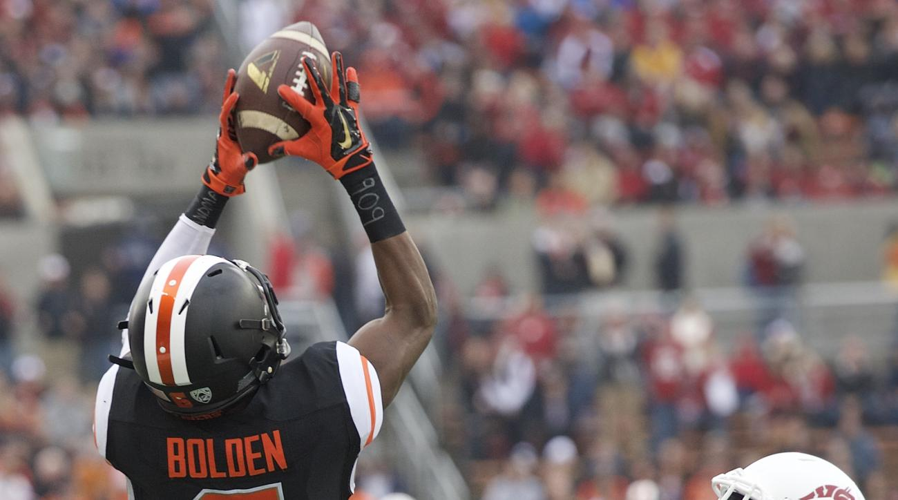 FILE - In this Nov. 8, 2014, file photo, Oregon State receiver Victor Bolden (6) picks up a first down on a pass reception over Washington State defender Charleston White (16) during an NCAA college football game in Corvallis, Ore. Bolden, a junior majori