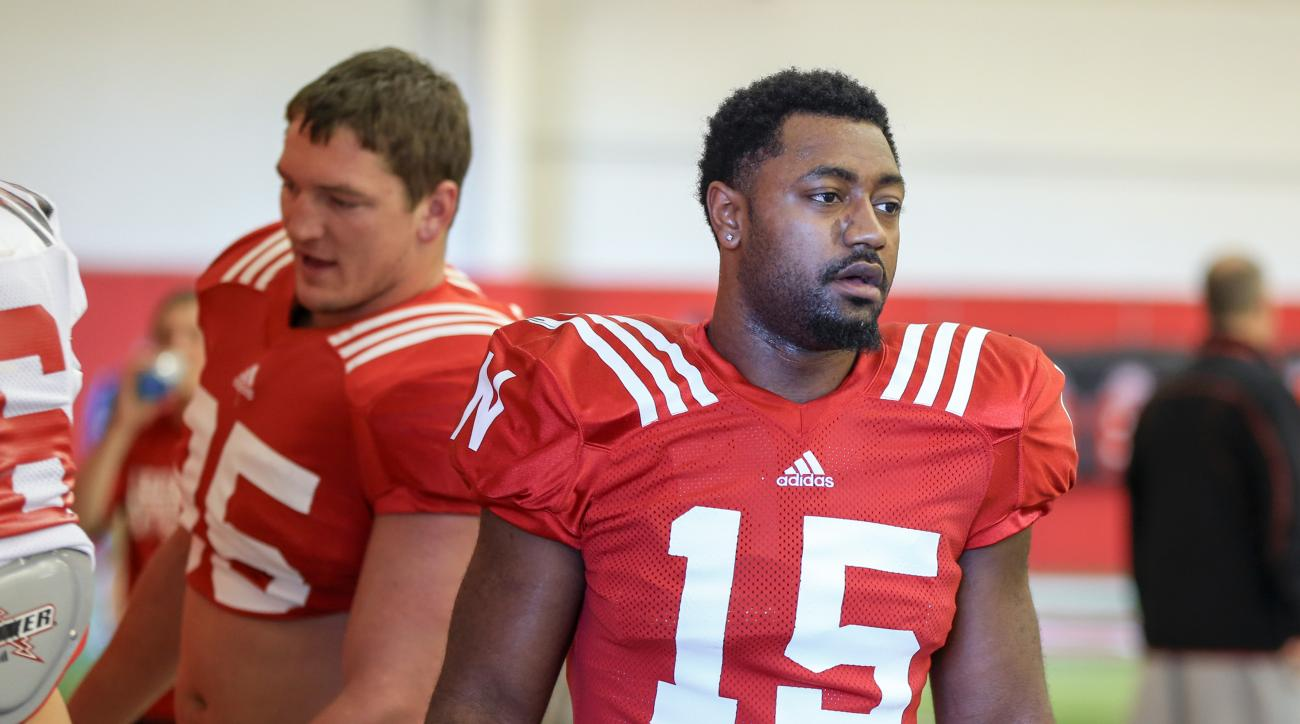 In this Tuesday, Aug. 11, 2015, photo, Nebraska linebacker Michael Rose-Ivey (15) and defensive end Jack Gangwish (95) arrive to NCAA college football practice in Lincoln, Neb. A year after he blew out a knee, Michael Rose-Ivey is back in his role as a st