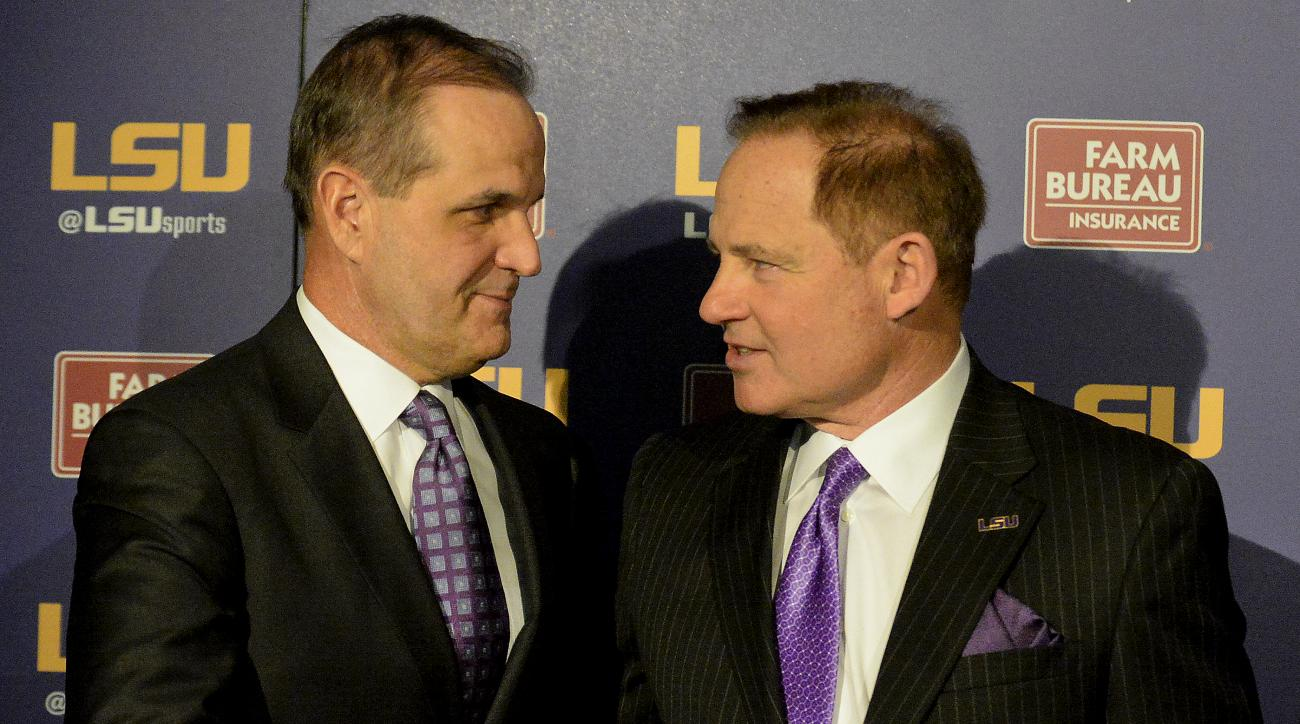 FILE - In this Jan. 14, 2015, file photo, LSU defensive coordinator Kevin Steele, left, shakes hands with LSU head coach Les Miles during a news conference at Louisiana State in Baton Rouge, La. As LSU's defense approaches its first game under new coordin