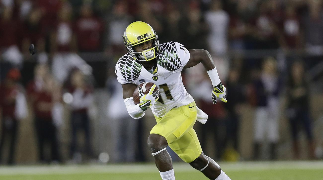 FILE - In this Nov. 7, 2013, file photo, Oregon wide receiver Bralon Addison (11) carries the ball against Stanford during an NCAA college football game in Stanford, Calif. Addison was a breakout star at receiver for the Ducks in 2013, with 61 catches for