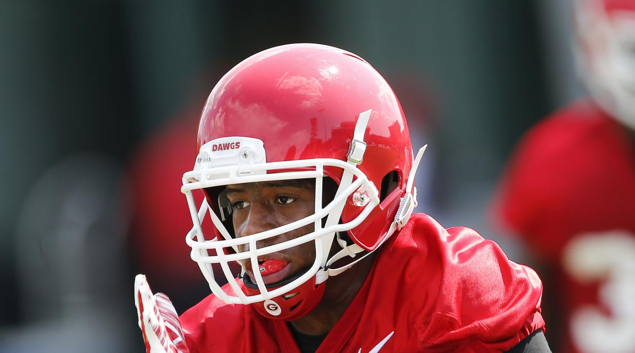 FILE - In this Aug. 4, 2015, file photo, Georgia running back Nick Chubb runs the ball during a NCAA college football practice in Athens, Ga. Chubb says he's confident in each of the three contenders in Georgia's quarterback race.  (AP Photo/John Bazemore