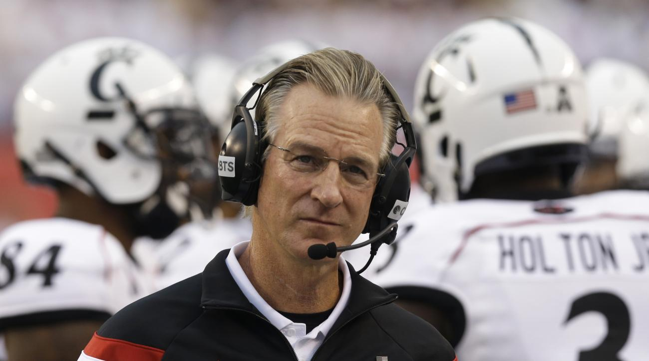 FILE - In this Sept. 12, 2014, file photo, Cincinnati head coach Tommy Tuberville works on the sidelines during the first half of an NCAA college football game against Toledo in Cincinnati. Tuberville's Bearcats  are favored to win the AAC this season ahe