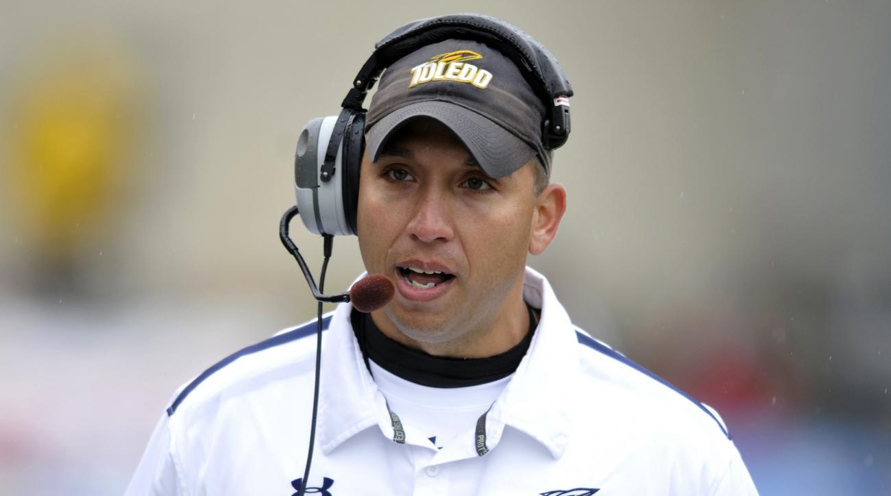 FILE - In this Oct. 19, 2013, file photo, Toledo head coach Matt Campbell talks during an NCAA college football game against Navy in Toledo, Ohio. For all its success in recent seasons, Toledo still hasn't been able to get past Northern Illinois in the MA