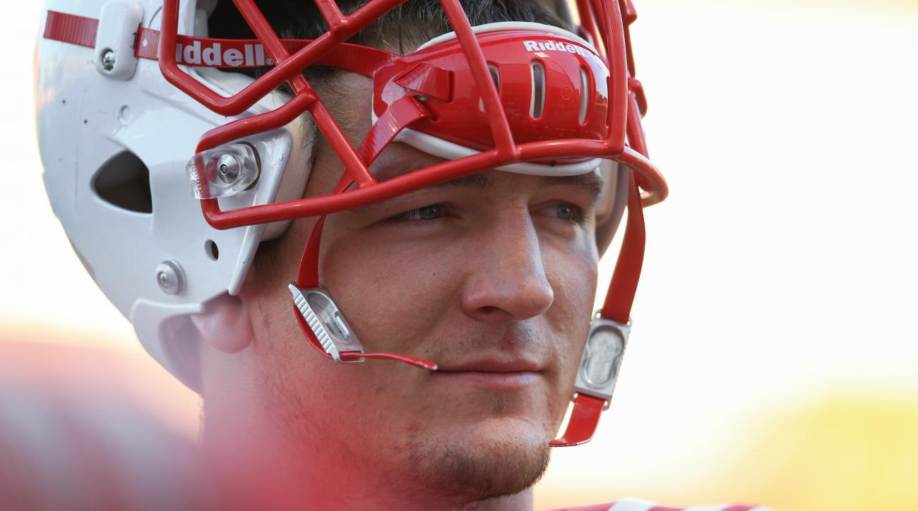FILE - In this Aug. 11, 2015 , file photo, Nebraska defensive end Jack Gangwish (95) looks on during NCAA college football practice in Lincoln, Neb. Fifth-year senior Jack Gangwish qualifies as the quintessential Nebraska walk-on success story. The defens