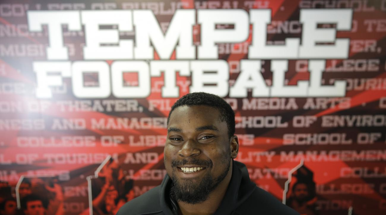 In this Thursday, Aug. 13, 2015, photo, Temple University football player Praise Martin-Oguike poses for a photograph in Philadelphia. The defensive end from Temple lost two years of his college football career after being charged in May 2012 with raping