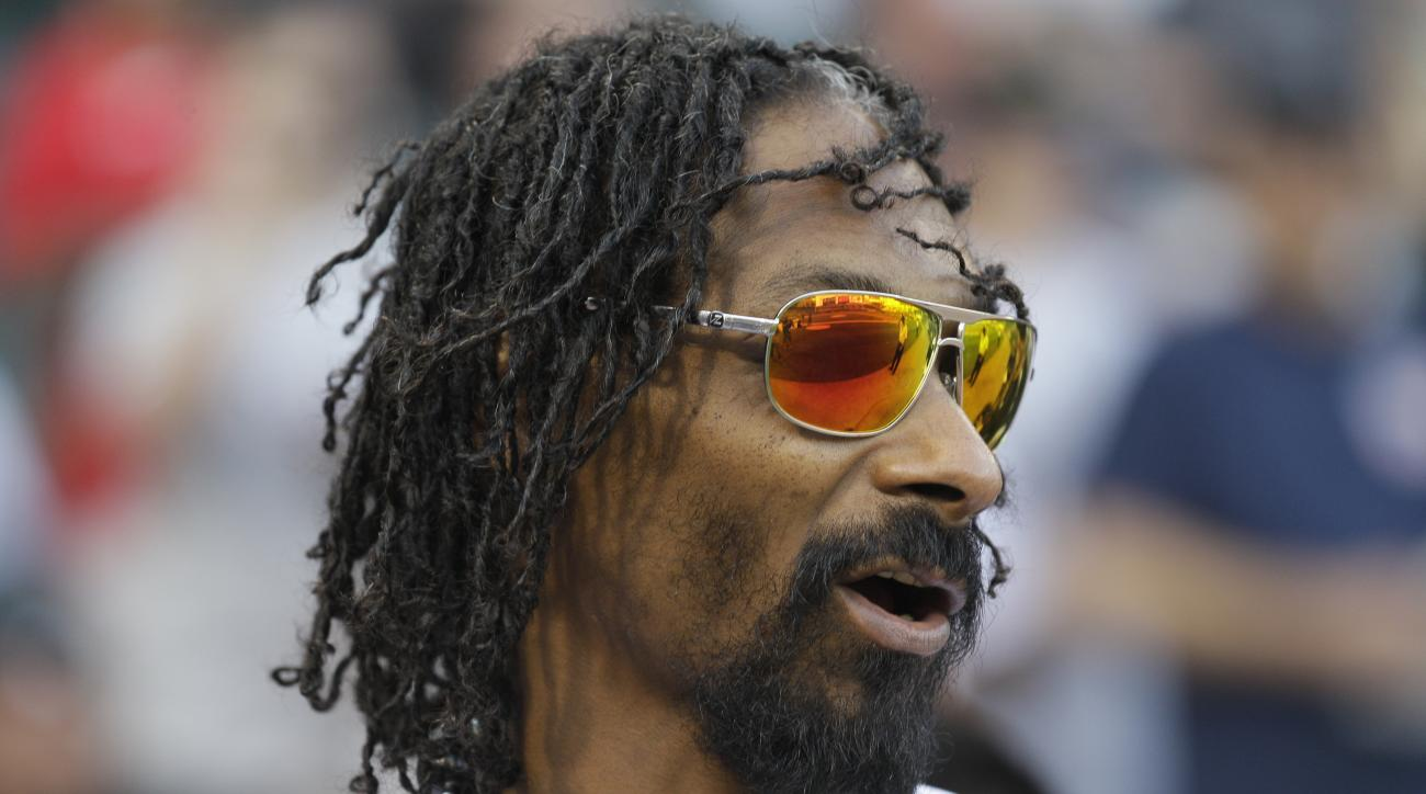 Snoop Dogg looks to the field before throwing out a ceremonial first pitch before a baseball game between the Minnesota Twins and the Chicago White Sox  in Chicago, Thursday, May 24, 2012. (AP Photo/Nam Y. Huh)