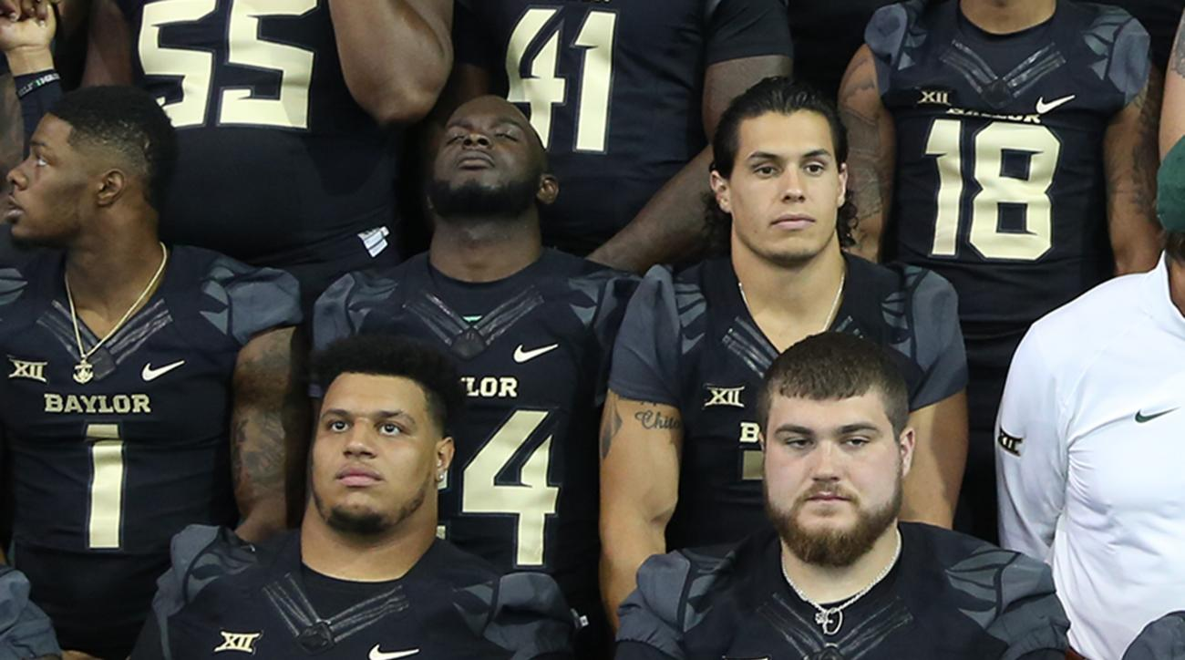 Baylor seniors Jarell Broxton (61) and Spencer Drango (58) line up with other members of the NCA college football for a team photo, Thursday, Aug. 13, 2015, in Waco, Texas. The numbers on the two players' jerseys reflect the score of last year's game with