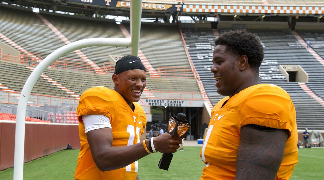 Tennessee quarterback Joshua Dobbs, left, interviews defensive lineman Kahlil McKenzie during media day Friday, Aug. 14, 2015, in Knoxville, Tenn. (Jessica Tezak/Knoxville News Sentinel, via AP) MANDATORY CREDIT