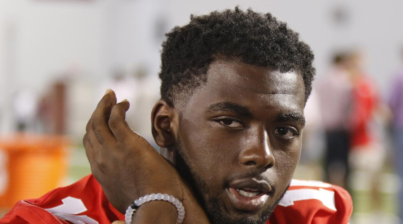 Ohio State quarterback J.T. Barrett speaks to reporters during the university's NCAA college football media day in Columbus, Ohio, Sunday, Aug. 16, 2015. (AP Photo/Paul Vernon)