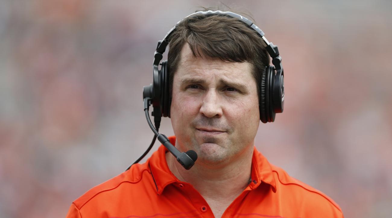 FILE - In this April 18, 2015, file photo, Auburn defensive coordinator Will Muschamp walks around the football field in the first quarter during their spring NCAA college football game in Auburn, Ala. The Tigers are expecting big things from new starting