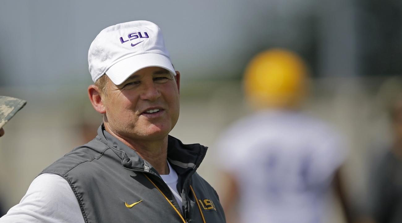 FILE - In this Aug. 7, 2015, file photo, LSU head coach Les Miles watches during NCAA college football practice in Baton Rouge, La. Les Miles enters his second decade as LSU's coach facing a little more pressure than usual.  (AP Photo/Gerald Herbert, File