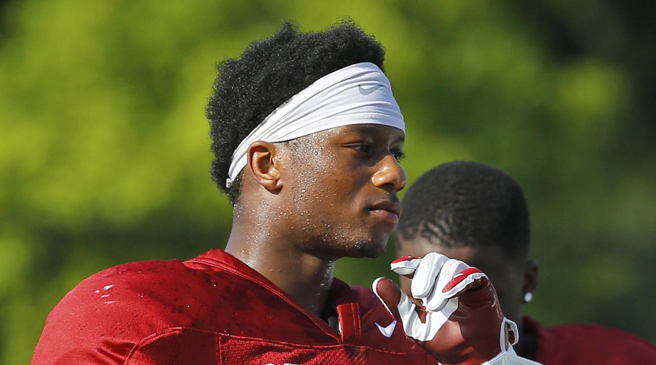 FILE - In this Aug. 10, 2015, file photo, Oklahoma running back Joe Mixon is shown during an Oklahoma NCAA college football practice in Norman, Okla. Oklahoma running back Joe Mixon, who was suspended last season after punching a woman, is back and has im