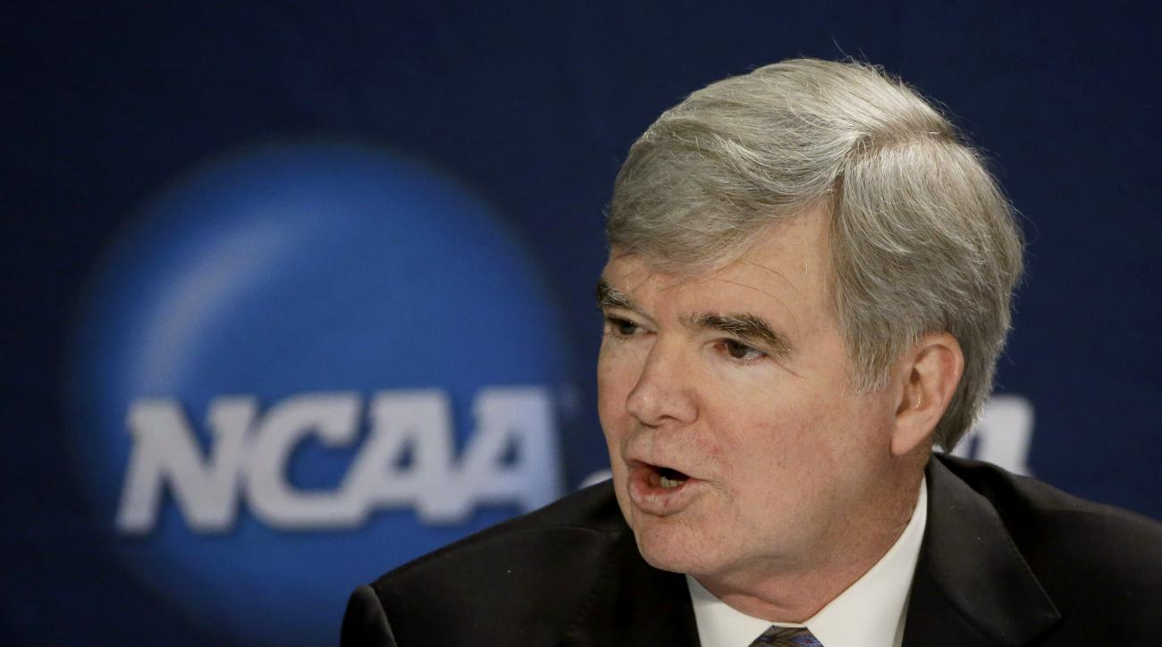 FILE - In this April 6, 2014, file photo, NCAA President Mark Emmert answers a question at a news conference in Arlington, Texas. The National Labor Relations Board has dismissed a historic ruling that Northwestern University football players are school e