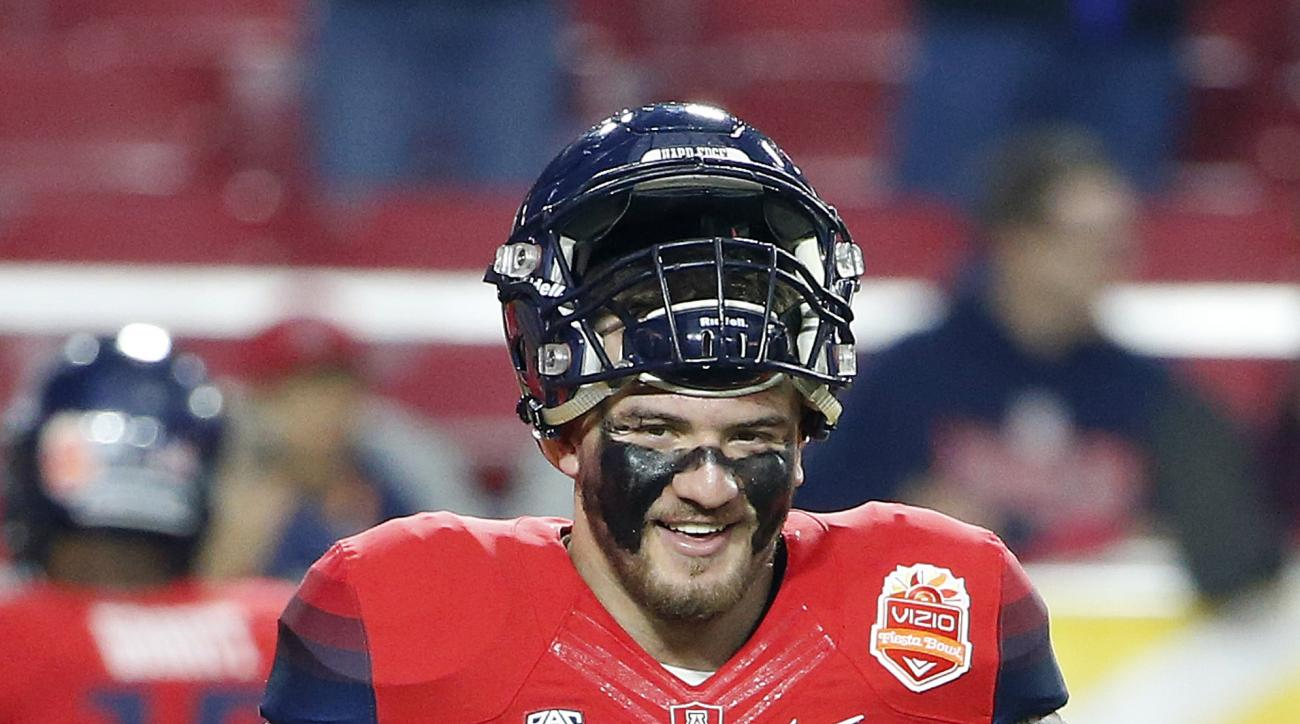 FILe - In this Dec. 31, 2014, file photo, Arizona's Scooby Wright III smiles as he walks on the field prior to the Fiesta Bowl NCAA college football game against Boise State in Glendale, Ariz. Arizona returns most of its skill players on offense and All-A