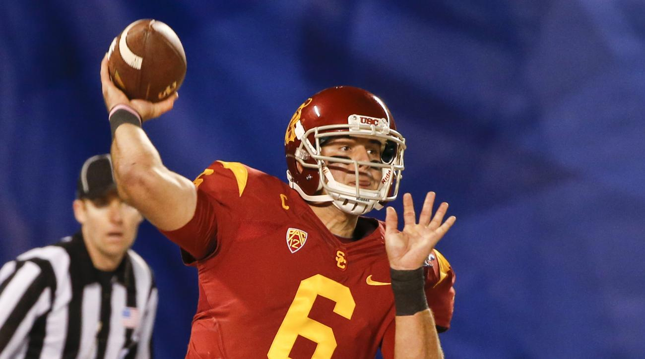 FILE - In this Dec. 27, 2014, file photo, Southern California quarterback Cody Kessler throws a pass against Nebraska during the first half of the Holiday Bowl NCAA college football game in San Diego. Kessler thinks his third season as USC's starting quar
