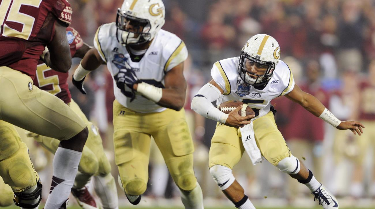 FILE- In this Dec. 6, 2014 file photo, Georgia Tech quarterback Justin Thomas, right, runs against Florida State during the first half of the Atlantic Coast Conference championship NCAA college football game in Charlotte, N.C. Thomas and Georgia Tech are