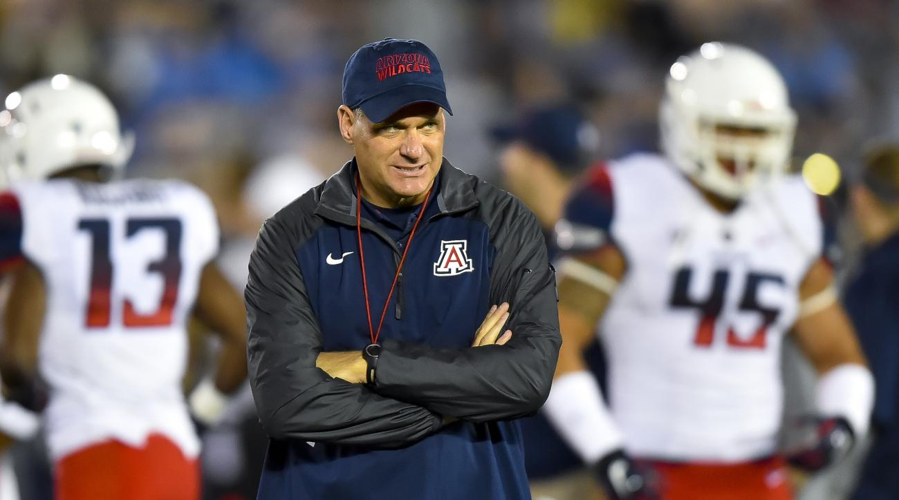 FILE - In this Nov. 1, 2014, file photo, Arizona coach Rich Rodriguez walks the field before his team's NCAA college football game against UCLA in Pasadena, Calif. Arizona won last season's Pac-12 South title by reeling off five wins in six games followin