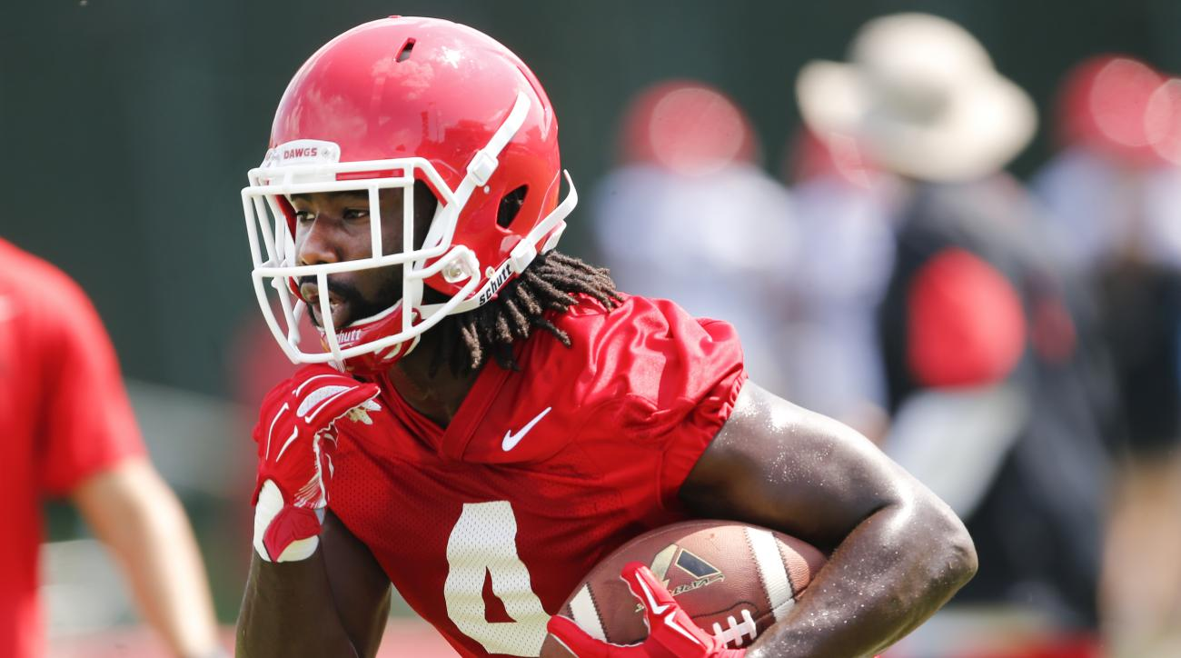In this photo taken Aug. 4, 2015, Georgia running back Keith Marshall (4) carries the ball during  NCAA college football practice in Athens, Ga. Marshall's return to good health is a big reason Georgia believes it will have quality depth behind tailback N