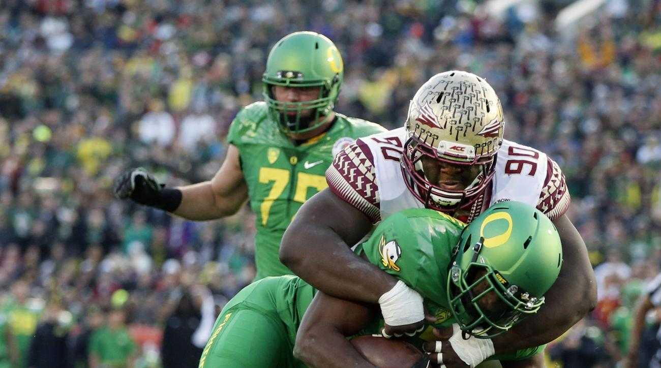 FILE - In this Jan. 1, 2015, file photo, Oregon running back Royce Freeman, front, scores past Florida State defensive tackle Eddie Goldman during the second half of the Rose Bowl NCAA college football playoff semifinal in Pasadena, Calif.  Just a sophomo
