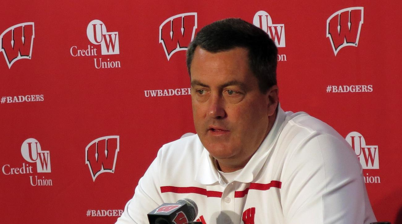 In this photo taken Sunday, Aug. 9, 2015, Wisconsin coach Paul Chryst answers a question during NCAA college football media day at Camp Randall Stadium in Madison, Wis. The former Badgers offensive coordinator is entering his first season as head coach at