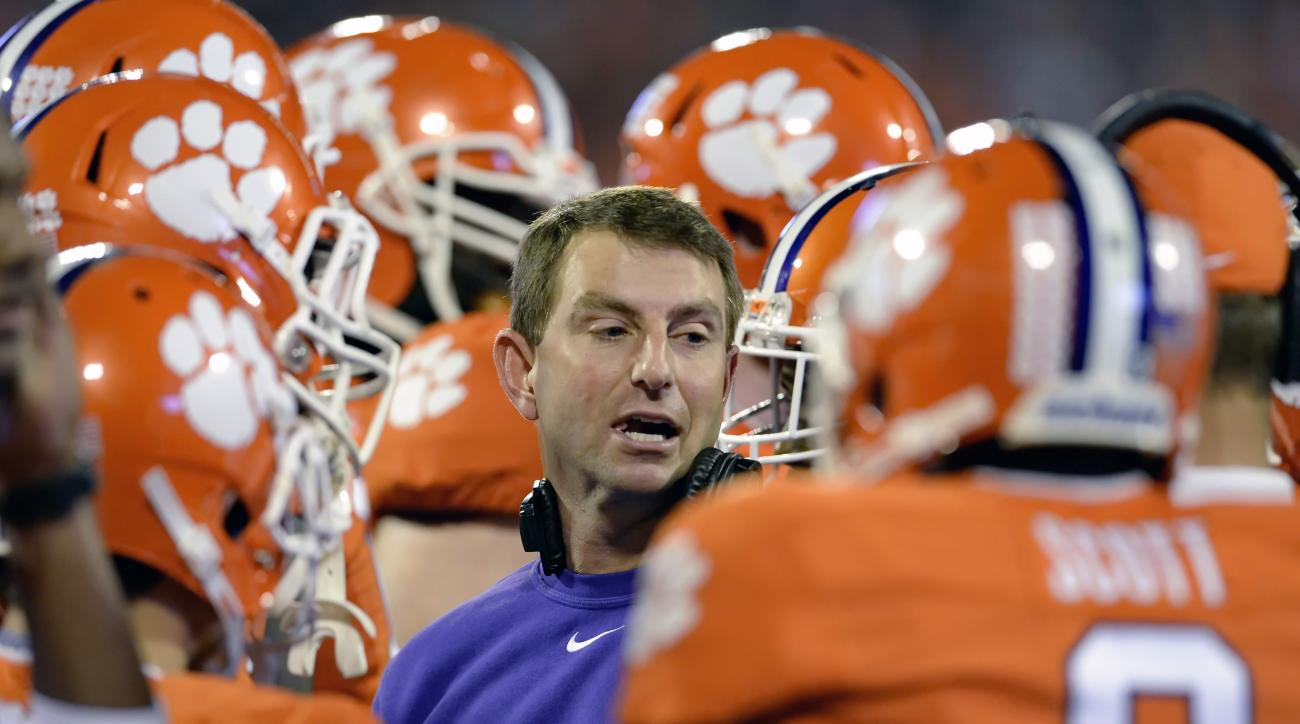 FILE - In this Oct. 25, 2014, file photo, Clemson coach Dabo Swinney talks to his team during an NCAA college football game against Syracuse in Clemson, S.C. Swinney said quarterback Deshaun Watson was selected the Atlantic Coast Conference's preseason pl