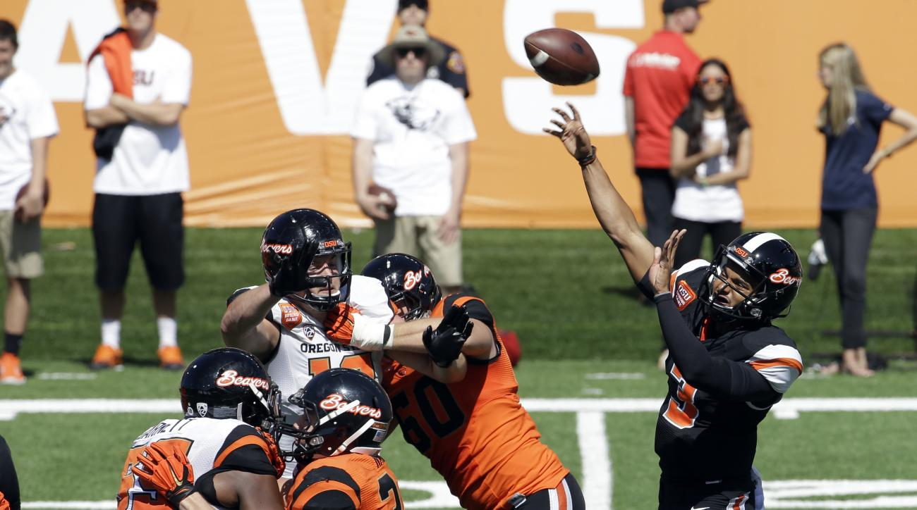 FILE - In this April 18, 2015, file photo, Oregon State quarterback Marcus McMaryion passes during the second half of their NCAA college football spring game in Corvallis, Ore. Three players are vying for the Beavers' starting quarterback position and abo