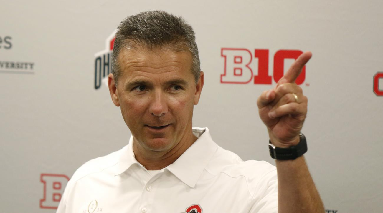 FILE - In this Aug. 16, 2015, file photo, Ohio State coach Urban Meyer speaks to reporters during the university's NCAA college football media day in Columbus, Ohio. Since taking over at Ohio State, Meyer has insisted he is a changed man, just as intense