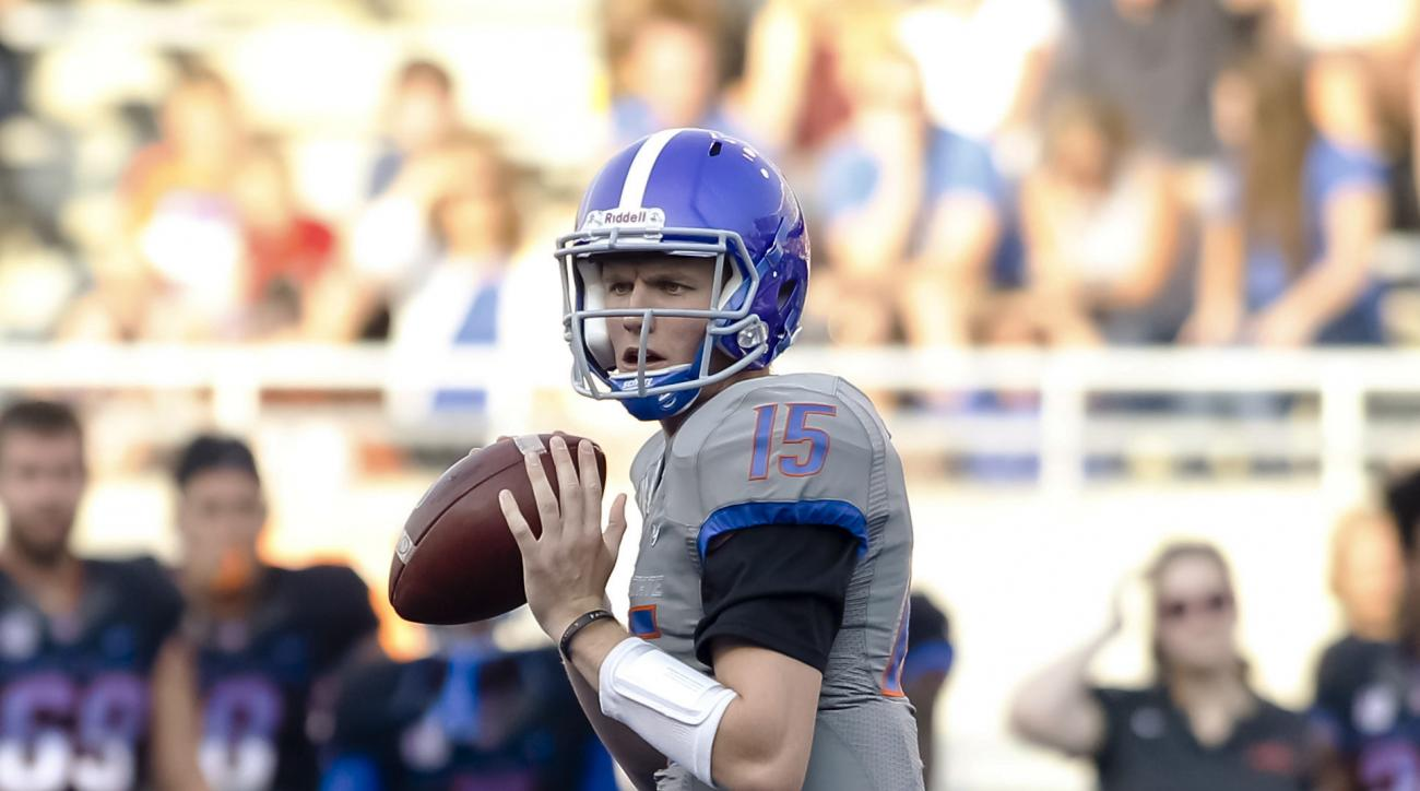 Boise State quarterback Ryan Finley looks for a receiver during an NCAA college football scrimmage in Boise, Idaho, on Friday, Aug. 21, 2015. (AP Photo/Otto Kitsinger)