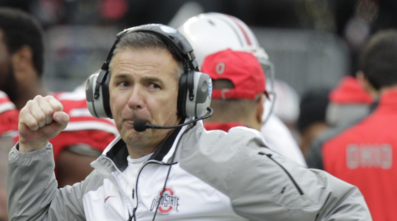 FILE - In this Nov. 29, 2014, file photo, Ohio State head coach Urban Meyer reacts to an Ohio State touchdown against Michigan during the fourth quarter of an NCAA college football game in Columbus, Ohio. The first matchup of Meyer and Michigan's Jim Harb