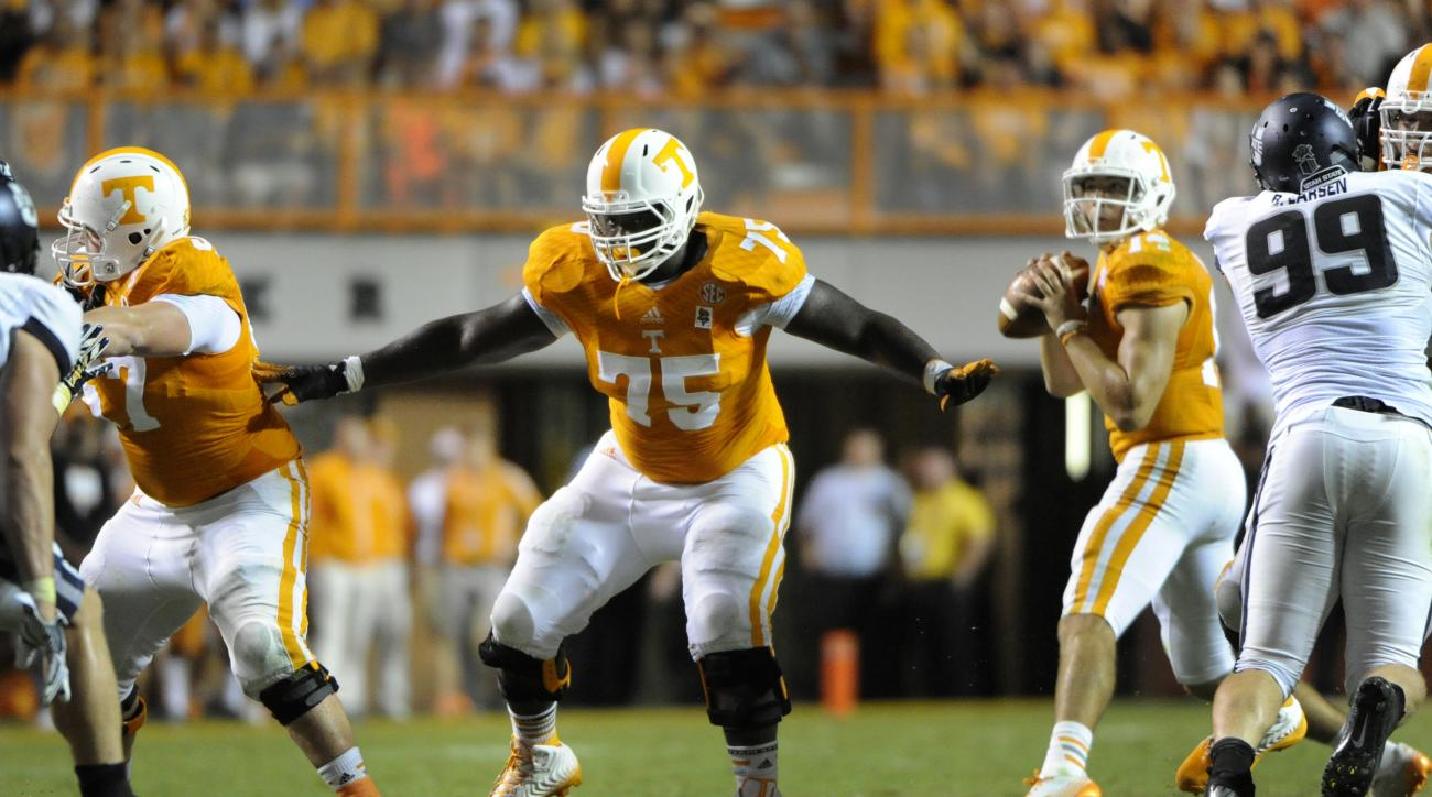 FILE - In this Aug. 31, 2014, file photo, Tennessee offensive lineman Marcus Jackson (75) provides pass protection during an NCAA college football game against Utah State in Knoxville, Tenn. Senior guard Marcus Jackson, the Vols' most experienced offensiv