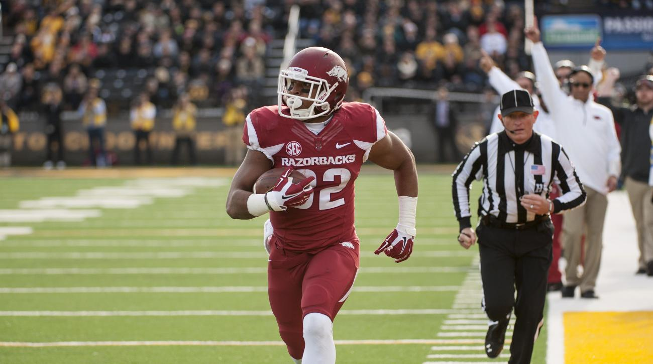 FILE - In this Nov. 28, 2014, file photo, Arkansas running back Jonathan Williams runs alone down the sideline as he scores on a 23-yard reception during the first quarter of an NCAA college football game against Missouri in Columbia, Mo. The 18th-ranked