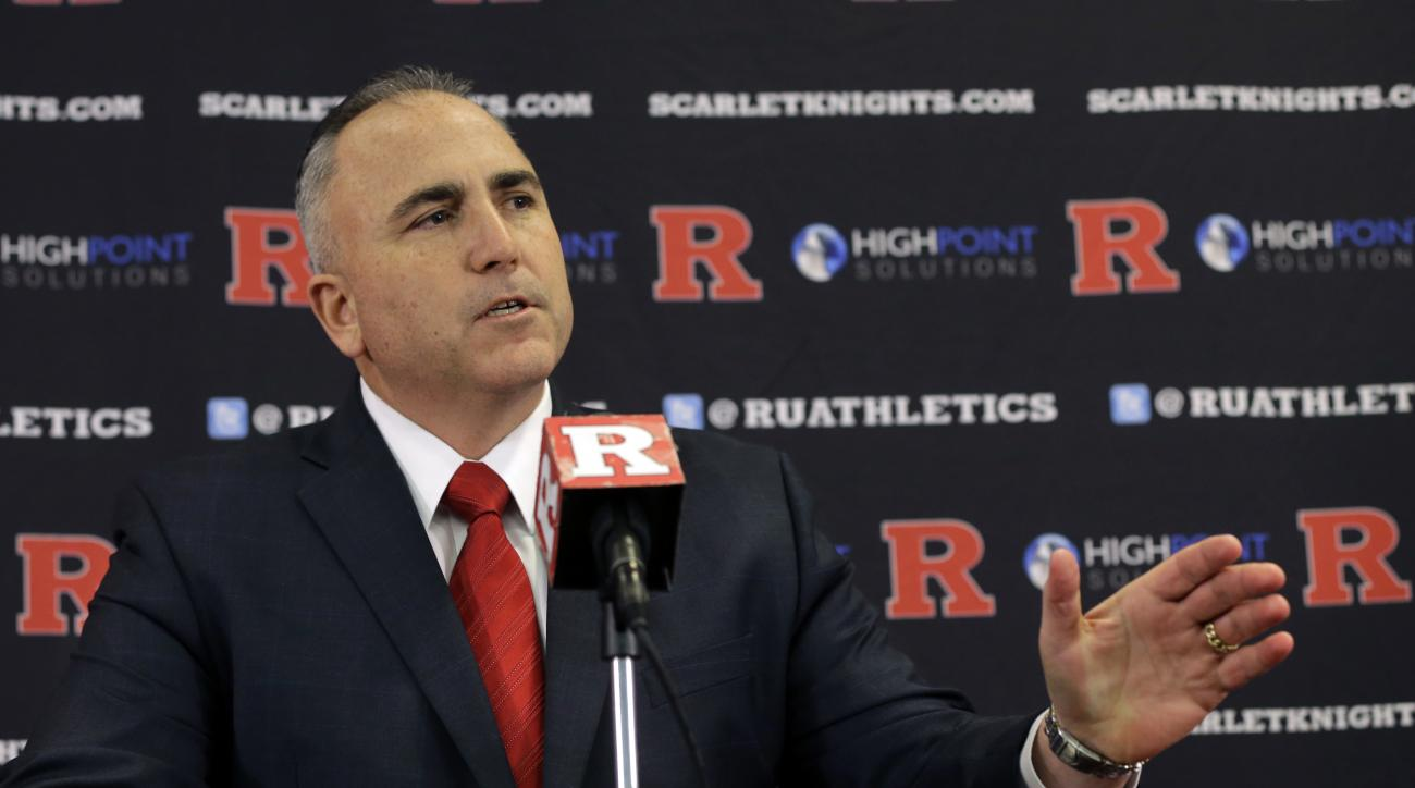 Rutgers football head coach Kyle Flood answers a question about the Scarlet Knights' recruiting class on national signing day, Wednesday, Feb. 4, 2015, in Piscataway, N.J. (AP Photo/Mel Evans)