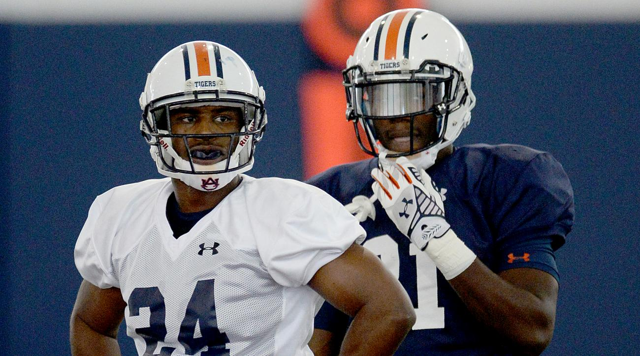 In this photo taken Friday, Aug. 7, 2015, Auburn defensive back Blake Countess (24) and running back Kerryon Johnson (21) attends drills during NCAA college football practice at the Auburn Athletic Complex in Auburn, Ala. (Julie Bennett/AL.com via AP) MAG