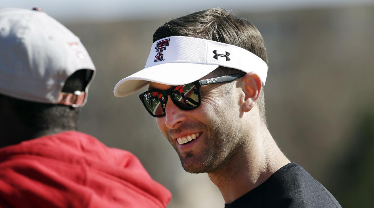 FILE - In this March 24, 2013, file photo, Texas Tech head coach Kliff Kingsbury visits on the sideline before a spring NCAA college football practice in Lubbock, Texas. Kingsbury has gone from hot young coach (not talking looks) to the handsome guy with
