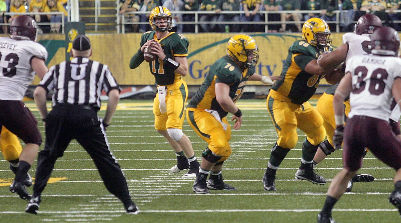 North Dakota State quarterback Carson Wentz set up in the pocket in the first half against Montana during an NCAA college football game Saturday, Sept. 20, 2014 at Fargodome in Fargo, North Dakota.  (AP Photo/Bruce Crummy)