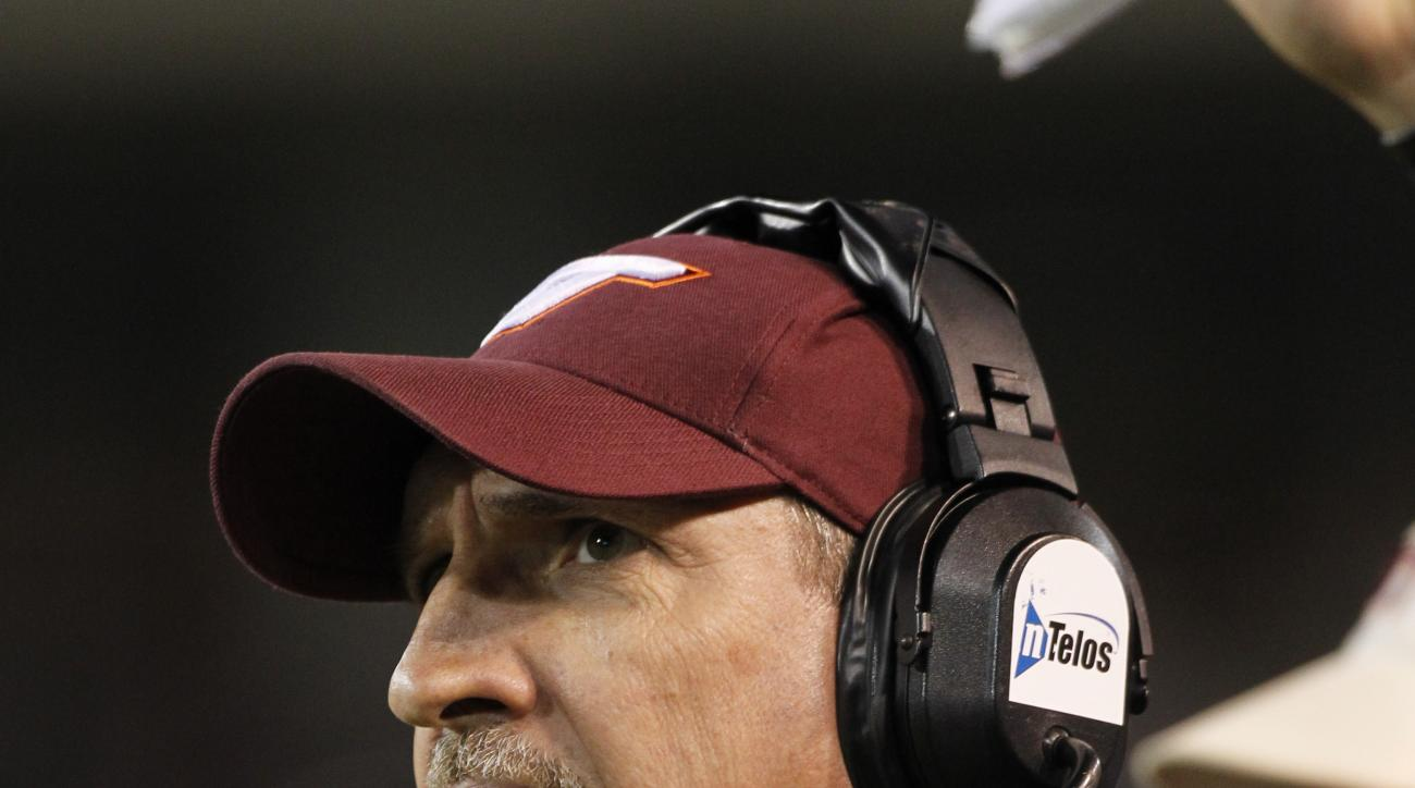 FILE - In this Oct. 15, 2011, file photo, Virginia Tech defensive coordinator Bud Foster against Wake Forest during the second half of an NCAA college football game in Winston-Salem, N.C. Foster found out quickly that just because his players have extra c