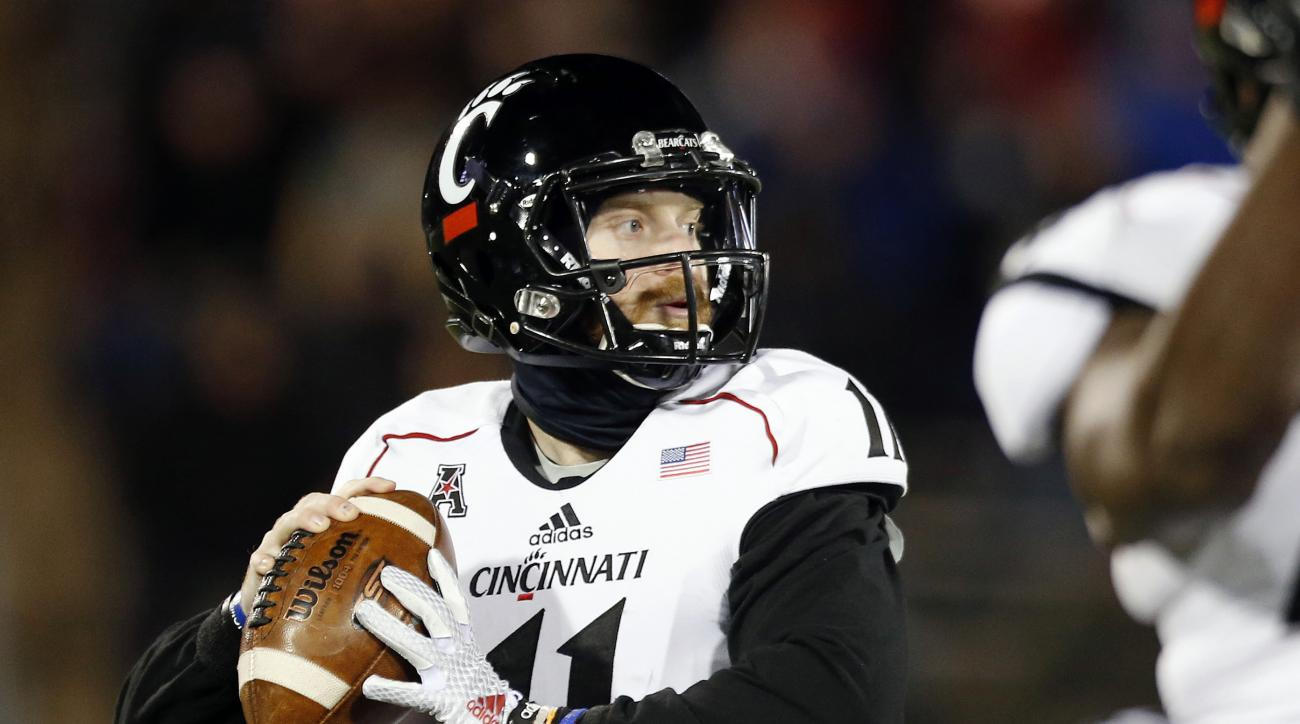 FILE- In this Nov. 22, 2014, file photo, Cincinnati quarterback Gunner Kiel looks to pass during an NCAA college football game against Connecticut in East Hartford, Conn. Heisman Trophy winners no longer need preseason hype and this season even the player