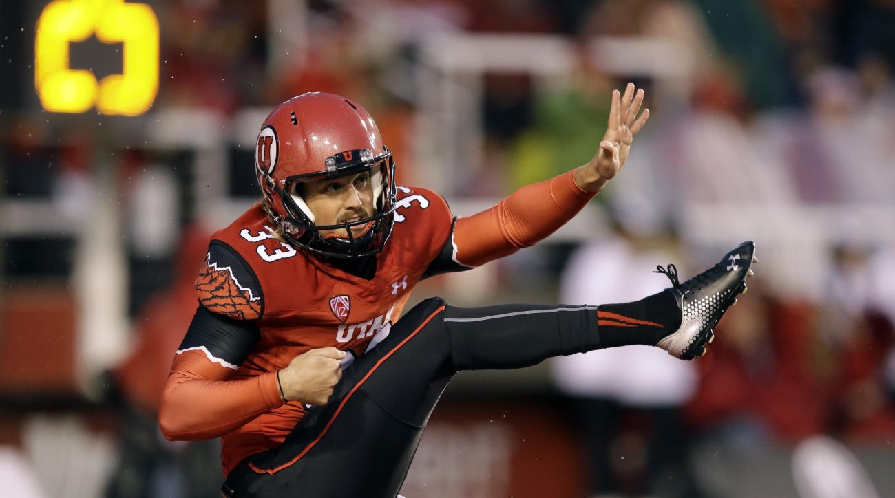 ADVANCE FOR WEEKEND EDITIONS, AUG. 29-30 - FILE - In this Sept. 27, 2014, file photo, Utah punter Tom Hackett (33) punts in the first half during an NCAA college football game against Washington State  in Salt Lake City. The past two Ray Guy Awards, given