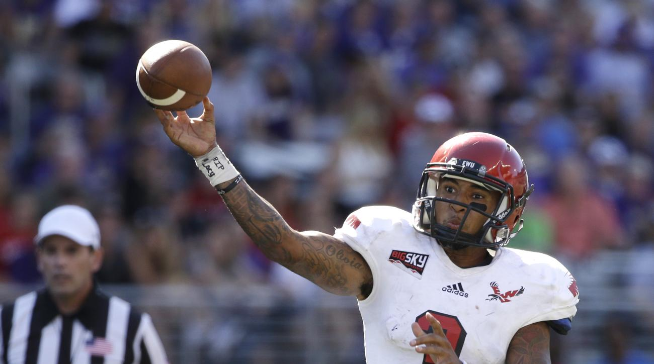 FILE - In this Sept. 6, 2014, file photo, Eastern Washington quarterback Vernon Adams Jr. throws a pass against the Washington Huskies in the second half of an NCAA college football game  in Seattle, Wash.  Oregon's quest to replace quarterback Marcus M
