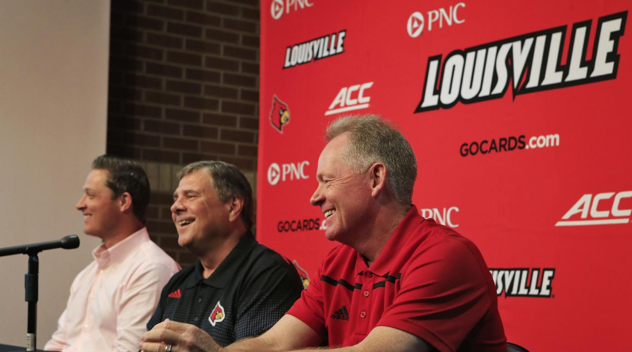 Louisville football coach Bobby Petrino, right, athletic director Tom Jurich and Mark Jurich, left, senior associate athletic director for development, laugh while talking about a stadium expansion, Friday, Aug. 28, 2015, in Louisville, Ky. Louisville pla