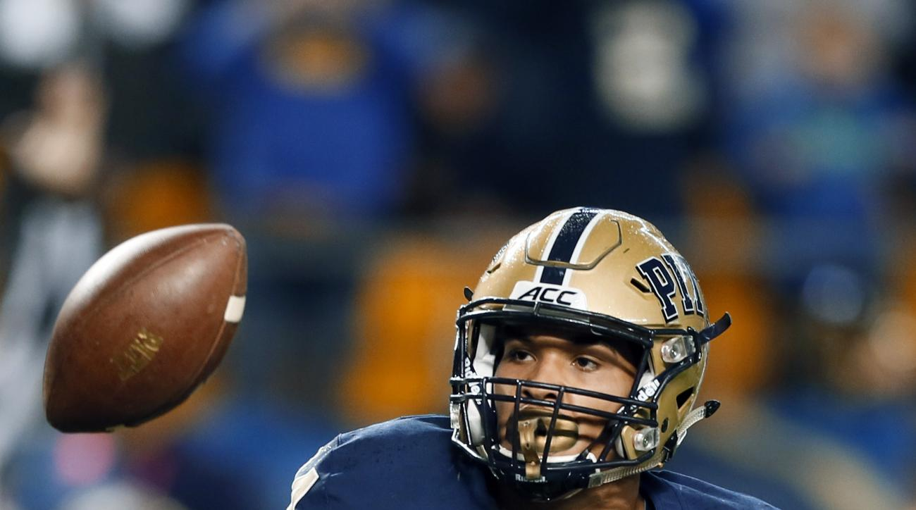 FILE -In this file photo from Oct. 16, 2014, Pittsburgh running back James Conner (24) tosses the ball to an official after scoring in the NCAA football game against Virginia Tech, in Pittsburgh. The reigning ACC Player of the Year is a star now, one with