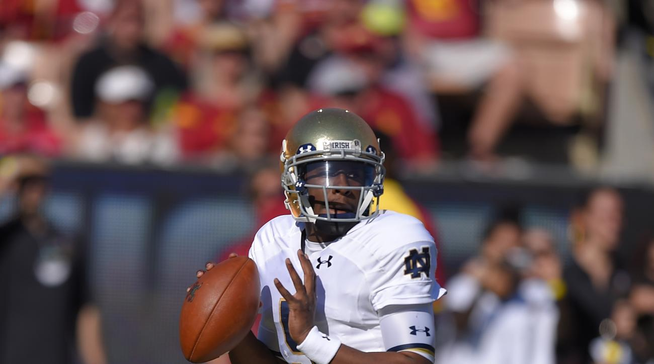 FILE - In this Nov. 29, 2014 file photo, Notre Dame quarterback Everett Golson gets set to pass during the first half an NCAA college football game against Southern California in Los Angeles. With a week until the opener against Texas State, Florida State
